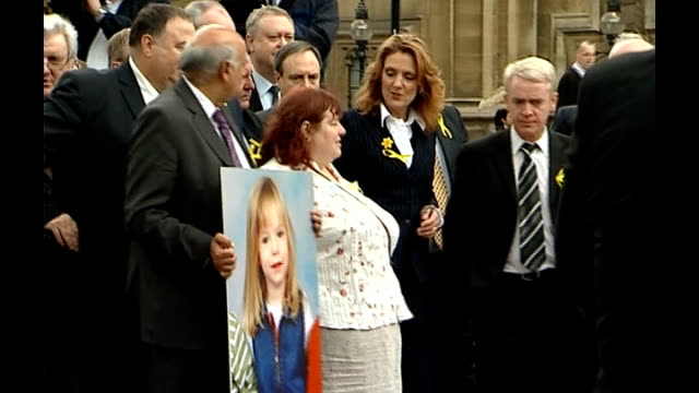 London Houses of Parliament EXT Philomena McCann along with MPs wearing yellow ribbons and blown up photograph of Madeleine at launch of fighting...