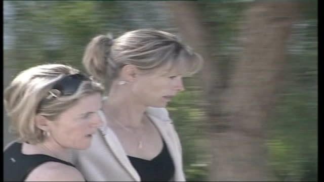 madeleine mccann missing: police to scale down search; kate mccann and others along to church int kate mccann sitting in church kate mccann taking... - マデリン・マクカーン失踪事件点の映像素材/bロール