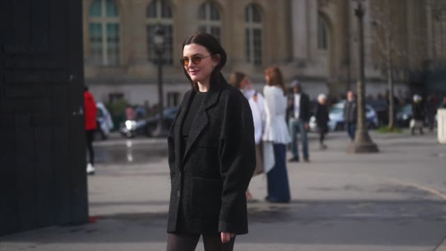 madelynn furlong wears sunglasses a black jacket a black top tights a semicircular bag black leather boots outside chanel during paris fashion week... - tights stock videos & royalty-free footage