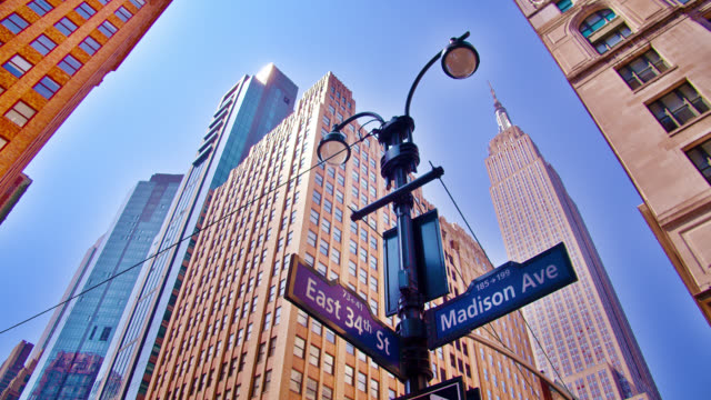 madison avenue. 34th street. empire state building - empire state building stock videos & royalty-free footage