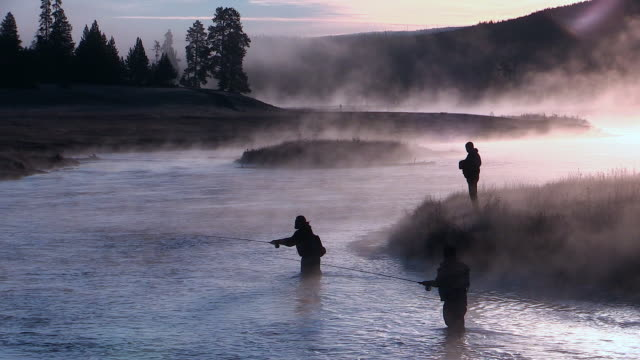 vídeos y material grabado en eventos de stock de madison river with mist rising, dawn, fishermen casting, autumn in yellowstone national park - wyoming