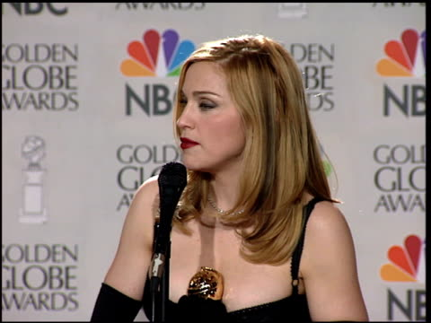 madonna at the 1997 golden globe awards at the beverly hilton in beverly hills, california on january 19, 1997. - anno 1997 video stock e b–roll