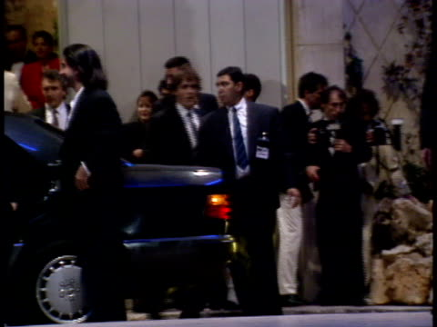 Madonna exits a limousine in front of the Palm Beach Hotel