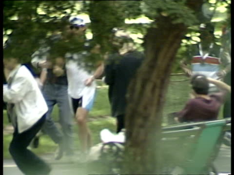 madonna jogging through green park as photographers try to keep up on august 14 1987 / london england/ audio - vest stock videos & royalty-free footage