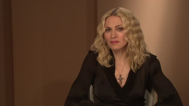 madonna on getting the message of the film i am because we are out to the public at the interview at the majestic hotel/salon royan ii room in cannes... - media interview stock videos and b-roll footage