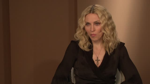 madonna on her priorities in life and on how her show business career funds her humanitarian work at the interview at the majestic hotel/salon royan... - media interview stock videos and b-roll footage