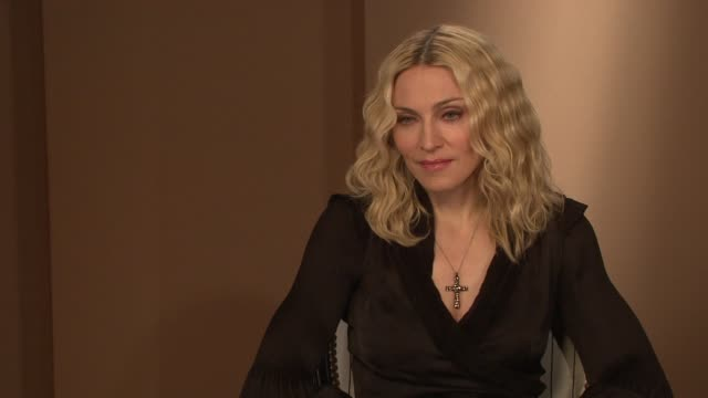 madonna on how she handled herself among the poverty in malawi and on how she's irrationally generous at times at the interview at the majestic... - media interview stock videos and b-roll footage