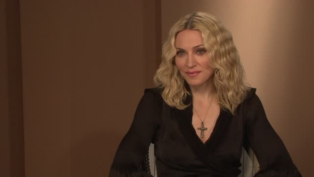 madonna on how tough the adoption period was and on the media coverage of her adoption process at the interview at the majestic hotel/salon royan ii... - media interview stock videos and b-roll footage