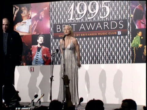 madonna on stage at press conference and answering questions at brit awards. madonna at brit awards press conference on february 20, 1995 in london - 1995 bildbanksvideor och videomaterial från bakom kulisserna