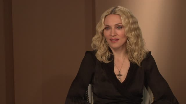 madonna on what she wants to audience to feel after watching the film i am because we are at the interview at the majestic hotel/salon royan ii room... - media interview stock videos and b-roll footage