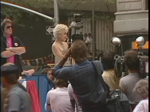 madonna stands on a stage with many press photographers in front of her she says into a microphone and 10 years later i'm standing in the middle of... - music or celebrities or fashion or film industry or film premiere or youth culture or novelty item or vacations stock videos & royalty-free footage