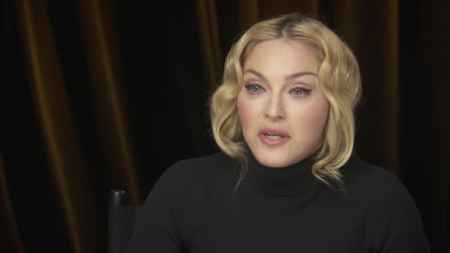 madonna talks about educating men as well as women while backstage at the chime for change benefit event to promote women's rights around the world. - produced segment stock videos & royalty-free footage