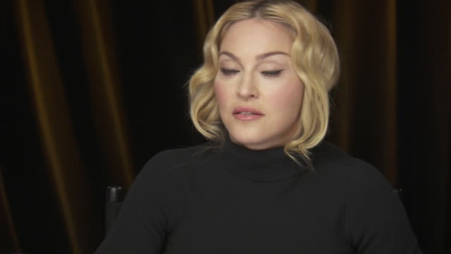 madonna talks about her philanthropic efforts for women while backstage at the chime for change benefit event to promote women's rights around the... - human rights or social issues or immigration or employment and labor or protest or riot or lgbtqi rights or women's rights stock videos & royalty-free footage