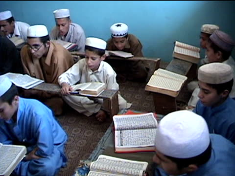 ws madrassa with boys reciting koran landi kotal in riffel agency of tribal zones federally administered tribal areas pakistan audio - madressa stock videos and b-roll footage