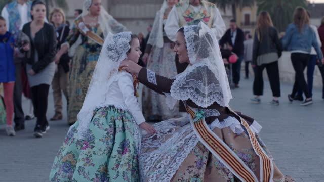 madre e hija vestidas de falleras - hija stock videos & royalty-free footage