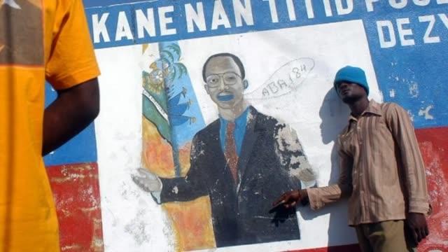 vídeos de stock e filmes b-roll de madrid, 16 dec .- jean-bertrand aristide was elected president of haiti, the poorest country in the americas, 21 years ago. looking back: aristide... - hispaniola