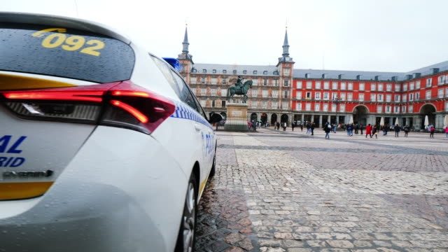 madrid police car at plaza mayor - mayor stock videos & royalty-free footage