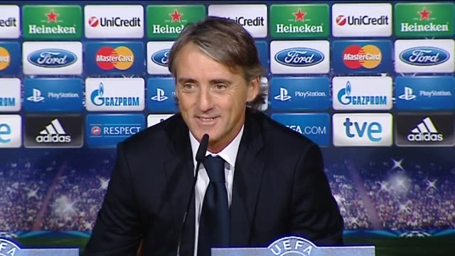 javier mariscal y enrique del viso manchester city's italian manager roberto mancini blamed his team's champions league loss to real madrid on the... - game of chance stock videos & royalty-free footage
