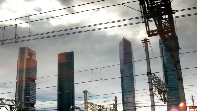 madrid sky crappers from the train window - 商業地域点の映像素材/bロール