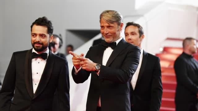 mads mikkelsen gestures to photographers on the 'arctic' red carpet during the 71st cannes film festival on may 8 2018 in cannes france - 71st international cannes film festival stock videos & royalty-free footage