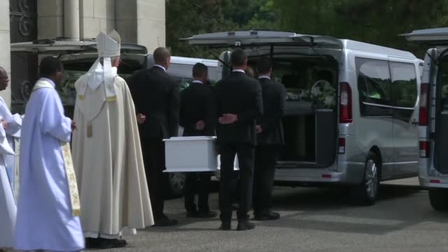 Maelys coffin is carried from a small French village church after the funeral attended by hundreds of well wishers