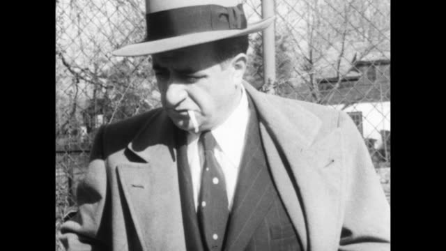 mafia boss albert anastasia with his lawyer and standing outside his house in fort lee new jersey smoking a cigarette / walks up driveway doberman... - mafia stock videos and b-roll footage