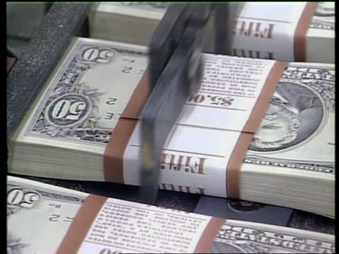 money laundering itn american dollars along on printing press - mafia stock videos and b-roll footage