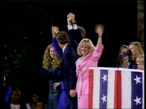 Money laundering LIB MAT HELD BUREAU Bill Clinton with daughter Chelsea Al Gore his wife Tipper along to podium holding hands in air at rally GV...