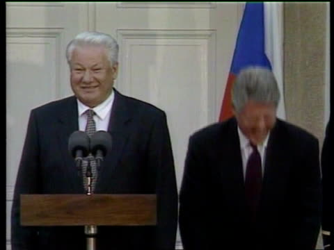 money laundering lib mat held bureau president bill clinton russian president boris yeltsin standing together on podium laughing side cms clinton... - bill clinton stock videos & royalty-free footage