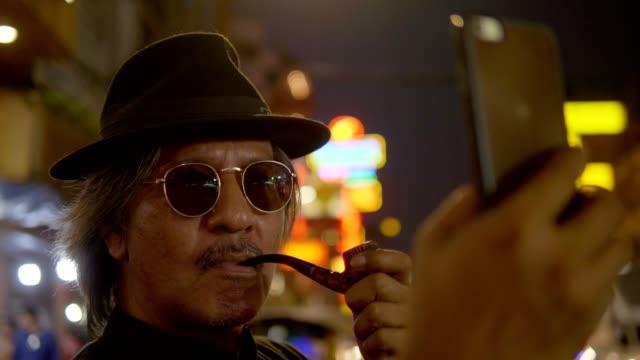 vidéos et rushes de mafia, voyageant à chinatown - lunettes de soleil