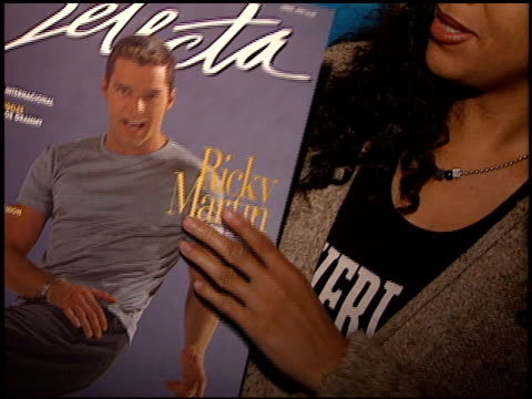 magazine cover at the ricky martin virgin cd party at virgin records in west hollywood, california on may 10, 1999. - ヴァージンレコード点の映像素材/bロール