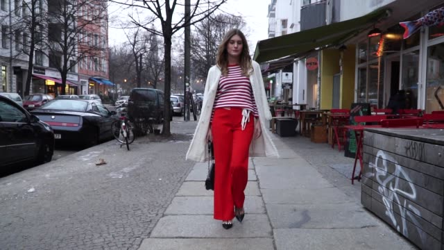 magdalena isic is wearing a red striped shirt, wool coat, red pants laurel, louis vuitton bag, valentino heels on january 17, 2017 in berlin, germany. - high heels stock videos & royalty-free footage