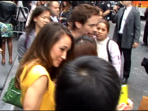 Maggie Q is all smiles while Shane West still looks serious as they depart the CW Upfronts in New York 05/19/11