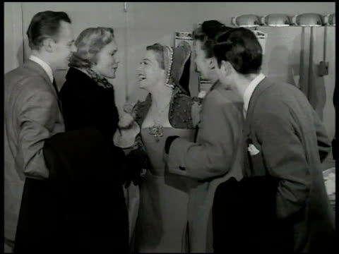 stockvideo's en b-roll-footage met dramatization 'maggie's' friends coming into dressing room backstage 'maggie' greeting friends leaving theatre out shubert stage door - 1949
