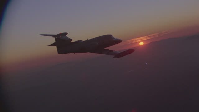 magic hour a-a learjet 23 (gorgeous!); series, first shot c.b. night - corporate jet stock videos & royalty-free footage