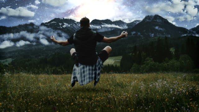 Magic in nature. Man levitating on the meadow