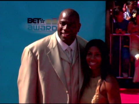 magic johnson and wife cookie at the 2005 bet awards arrivals at the kodak theatre in hollywood california on june 28 2005 - magic johnson stock videos and b-roll footage