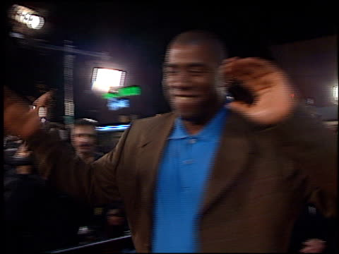 magic johnson at the 'any given sunday' premiere on december 16 1999 - magic johnson stock-videos und b-roll-filmmaterial