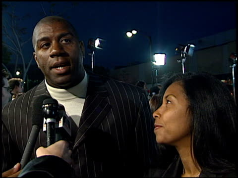 magic johnson at the 'life' premiere at the mann village theatre in westwood, california on april 14, 1999. - マジック・ジョンソン点の映像素材/bロール