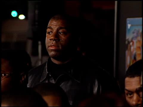 magic johnson at the 'next friday' premiere at the cinerama dome at arclight cinemas in hollywood, california on january 11, 2000. - マジック・ジョンソン点の映像素材/bロール