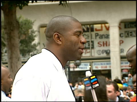 magic johnson at the 'steel' premiere at grauman's chinese theatre in hollywood california on august 9 1997 - magic johnson stock-videos und b-roll-filmmaterial