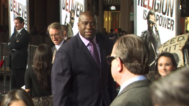 magic johnson at the 'the book of eli' premiere at hollywood ca. - マジック・ジョンソン点の映像素材/bロール