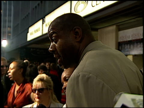 magic johnson at the 'why do fools fall in love' premiere at abc ent center in century city california on august 26 1998 - magic johnson stock-videos und b-roll-filmmaterial