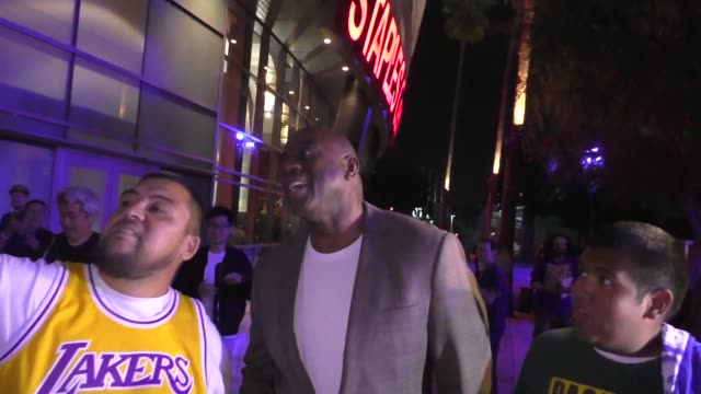magic johnson leaves the lakers vs clippers game at staples center in los angeles in celebrity sightings in los angeles, - マジック・ジョンソン点の映像素材/bロール