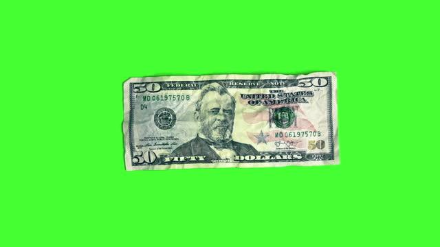 magic money: $1 dollar bill turns into $50 dollar bill on chroma key - loss stock videos & royalty-free footage