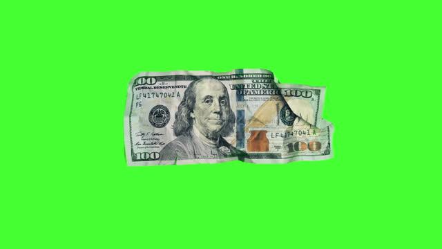 magic money: $100 dollar bill turns into $20 dollar bill on chroma key - wealth stock videos & royalty-free footage