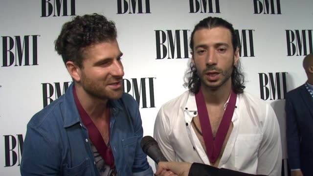vídeos de stock, filmes e b-roll de interview magic on the event and their music at the 63rd annual bmi pop awards at the beverly wilshire four seasons hotel on may 12 2015 in beverly... - four seasons hotel