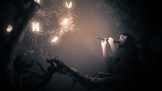 Magic scenes. Girl playing flute and glowing butterflies. Fantasy series.