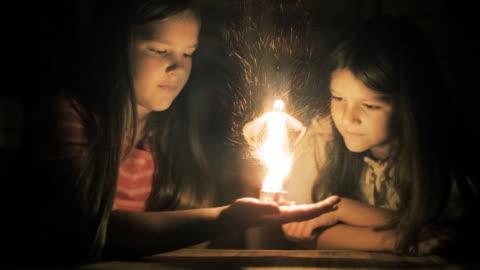 magic scenes. girls staring at flaming fairy. fantasy series. - fantasy stock videos & royalty-free footage