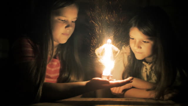 magic scenes. girls staring at flaming fairy. fantasy series. - fairy stock videos & royalty-free footage